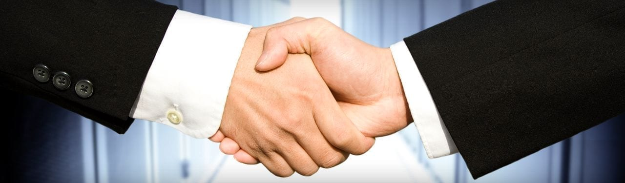 Businessmen shaking hands in agreement