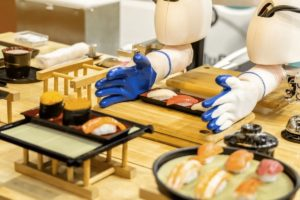 wooden kitchen counter with wooden cutting board and robotic arms